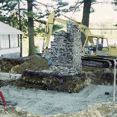 Excavating around the original cabin and stone fireplace that Steve Crook Design and Construction will work to restore.