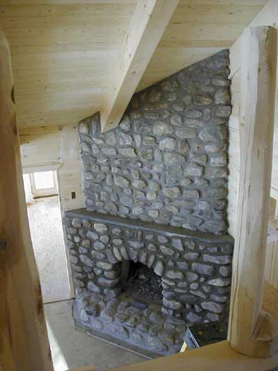 Picture of the refurbished old stone fireplace.